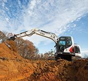 Bobcat 14-16T Size Class Large Excavator Digging Dirt On Jobsite