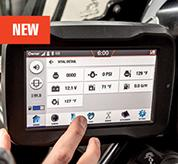 Operator Using Touchscreen Display Inside Bobcat Mini Excavator Cab