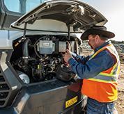 Operator Utilizing Panoramic Servicing on R2-Series Compact Excavator