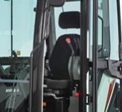 The Cab Doorway Of An E60 Compact Excavator And Heated High-Back Seat With Headrest Inside