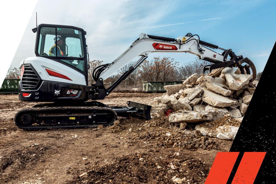 Bobcat E42 R2-Series Excavator With Grapple Attachment Move Large Concrete Debris On Jobsite
