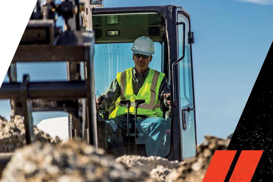 Operator Working In Comfort Inside The Cab Of An R-Series Compact Excavator