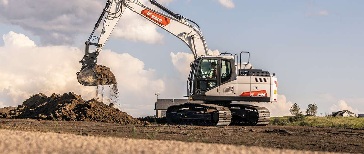 Bobcat E165 Large Excavator With Bucket Attachment Digging On Graded Ground