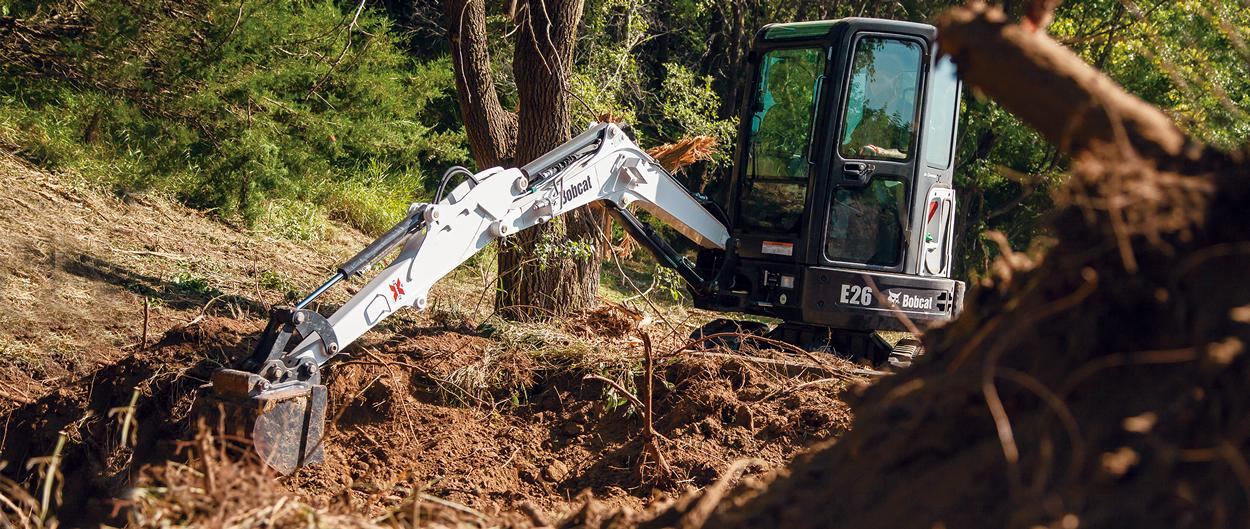 Bobcat E26 compact excavator (mini excavator) reaches farther.