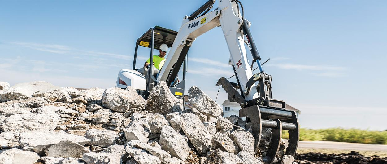 Bobcat E32 compact (mini) excavator with a grapple attachment.