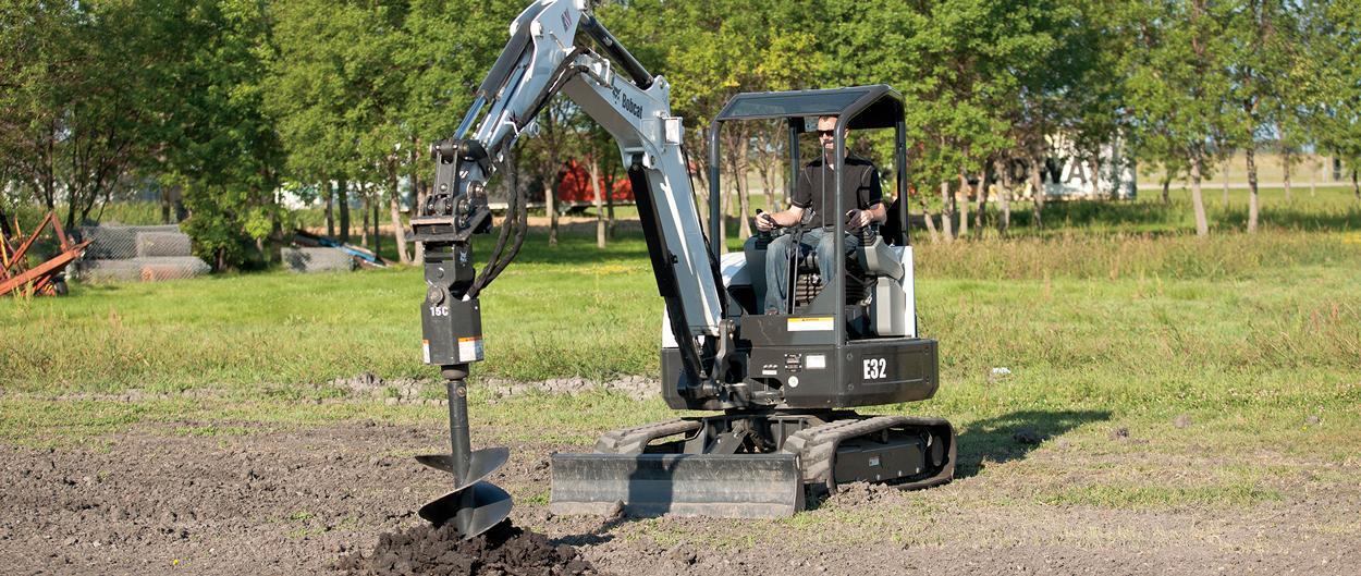 Bobcat E32 compact excavator (mini excavator) with auger attachment.