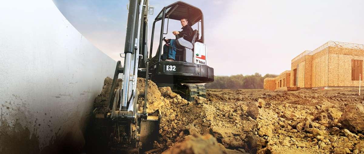 Bobcat compact excavator (mini excavator) digs along foundation.