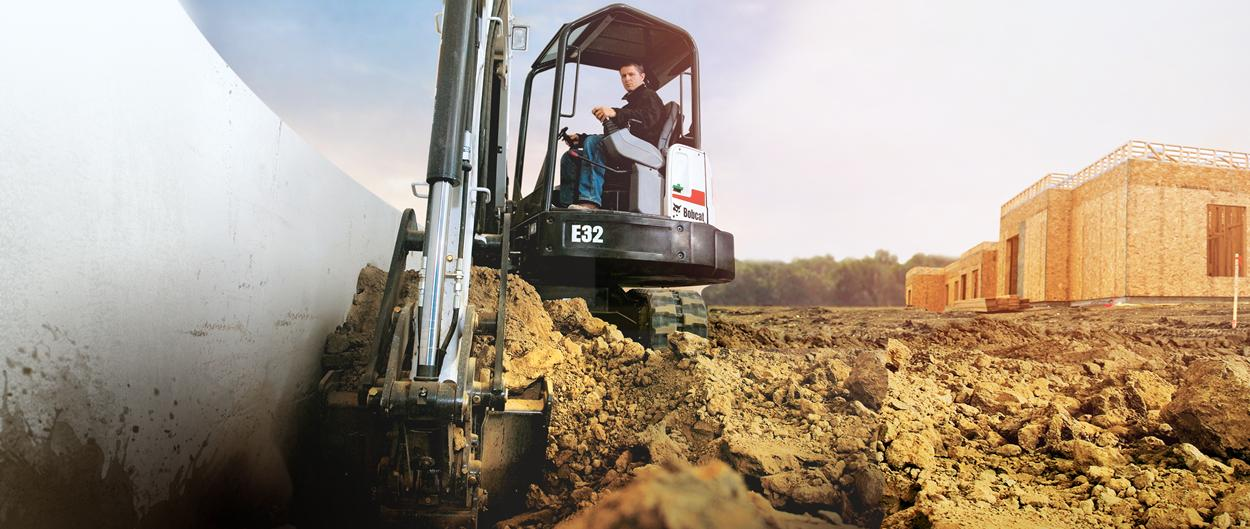 Bobcat compact excavator (mini excavator) digs along foundation.