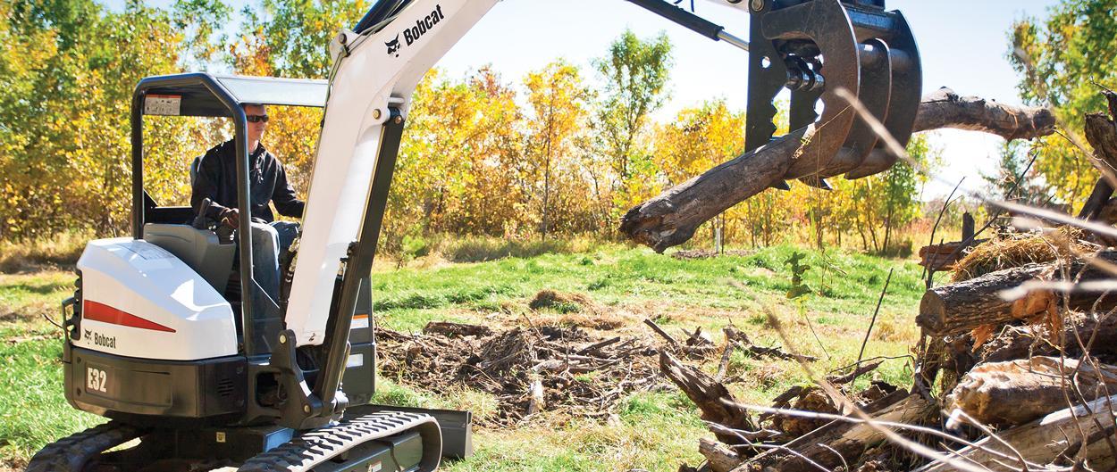 Bobcat E32 compact excavator (mini excavator) with clamp attachment.
