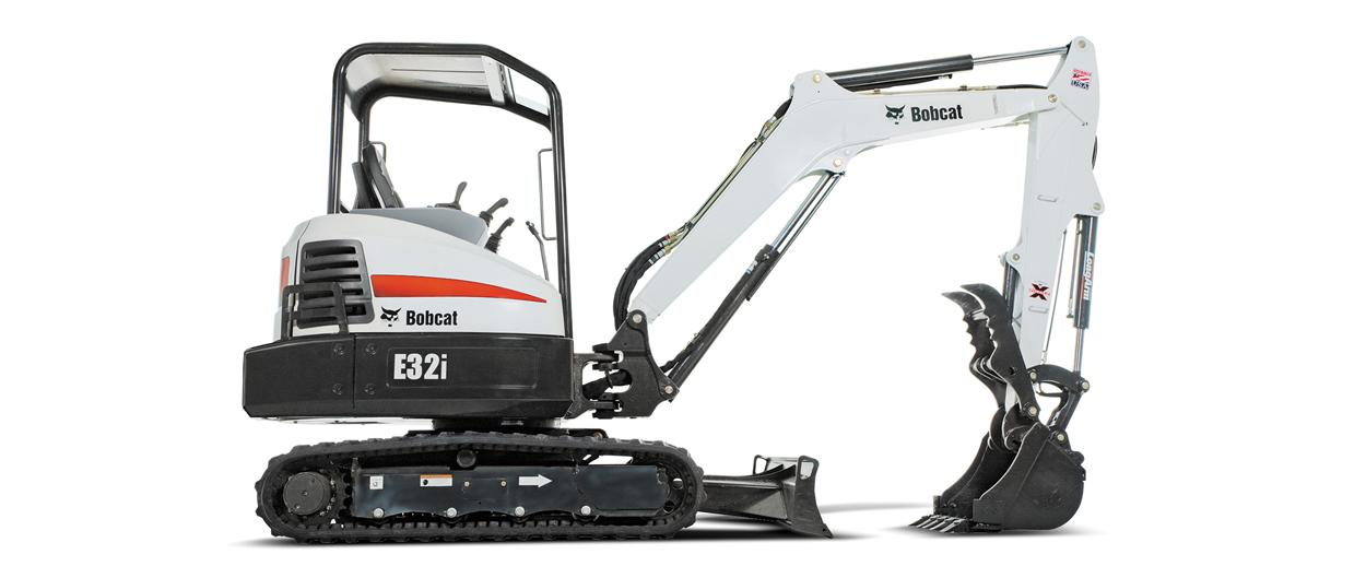Bobcat R-Series E32 compact (mini) excavator clearing jobsite with three-tine grapple attachment.