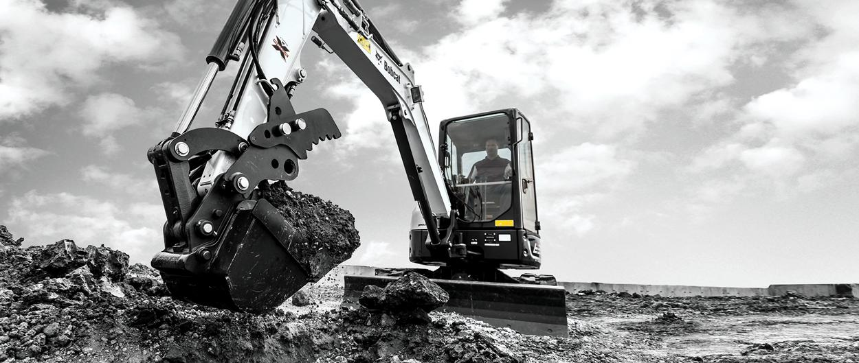 Bobcat Compact Excavator moving dirt