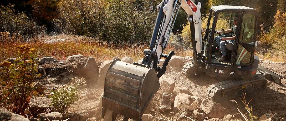 Excavator Operator Moving Rocks And Dirt