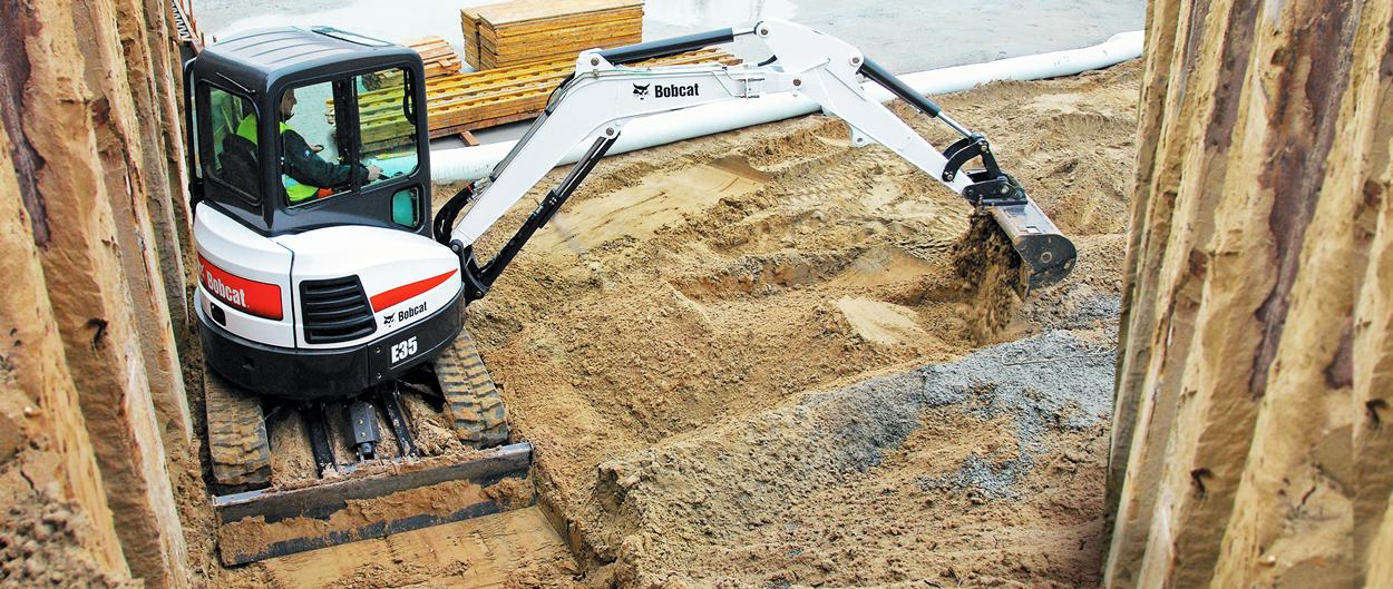Bobcat compact excavator working on a tough jobsite.