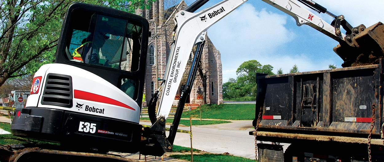 Bobcat R-Series E35 compact (mini) excavator with three-tine grapple attachment.