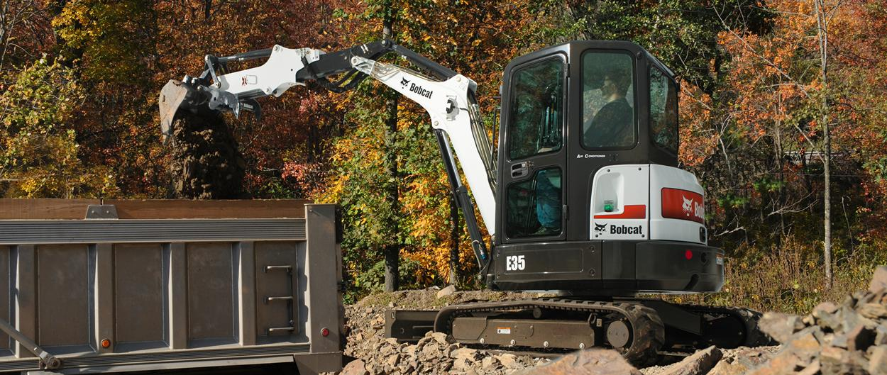 Bobcat R-Series E35 compact (mini) excavator with clamp attachment.