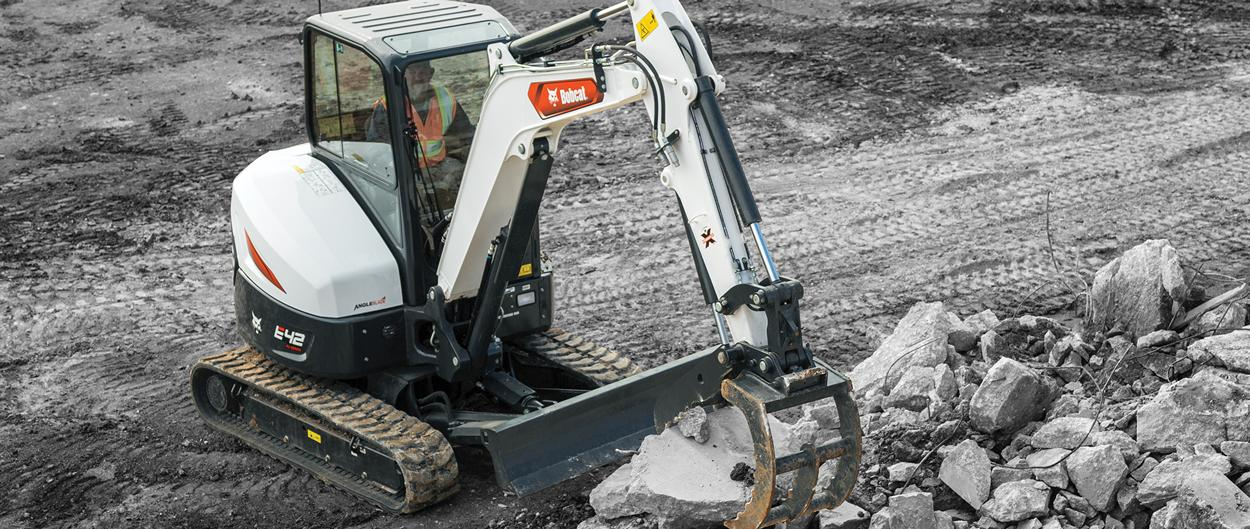 Bobcat E42 with 3-tine grapple attachment
