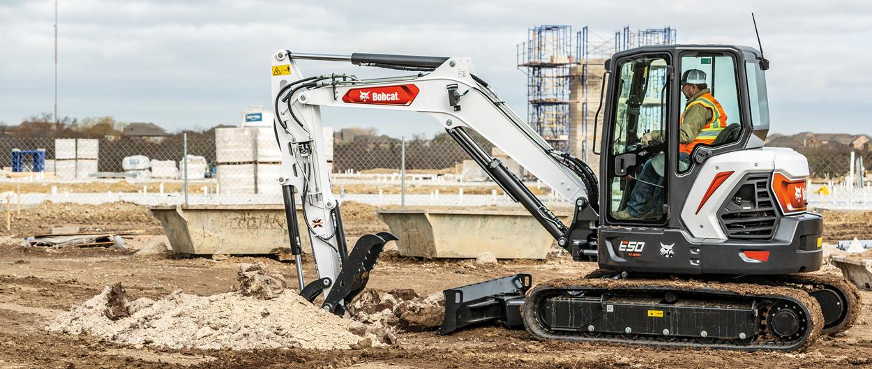 Compact Excavator Prepares Jobsite