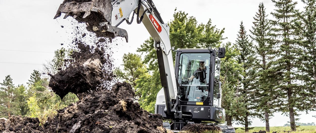 Bobcat E60 Compact Excavator Digging Dirt
