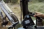 Bobcat depth check system inside a compact (mini) excavator cab.
