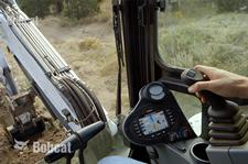 Bobcat compact (mini) excavator cab featuring the depth check system.