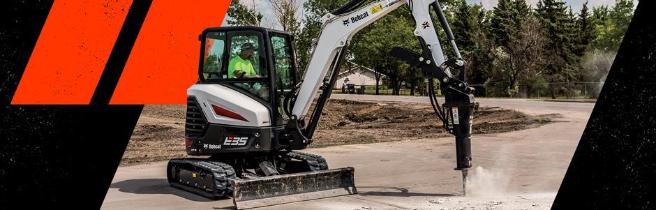 Operator Using Bobcat E35 Compact Excavator With Breaker Attachment To Break Through Concrete