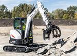 Bobcat E35 R-Series compact excavator moving concrete.