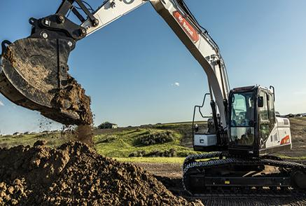 Bobcat Large Excavator On Jobsite Digging A Hole.