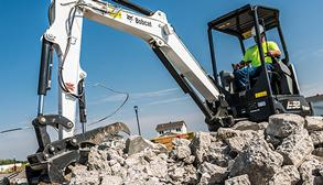 Bobcat E32 compact (mini) excavator and grapple attachment.