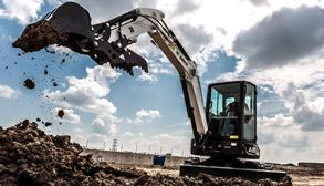 Bobcat E35 compact (mini) excavator and grapple attachment.