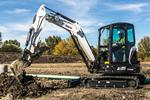 Bobcat E35 compact (mini) excavator digging a hole with a bucket.