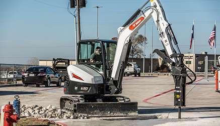 Bobcat E50 Compact Excavator With Nitrogen Breaker Attachment Breaking Concrete.