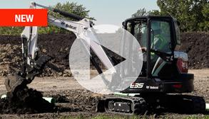 Bobcat E35  R-Series compact (mini) excavator digging a hole with a bucket attachment.