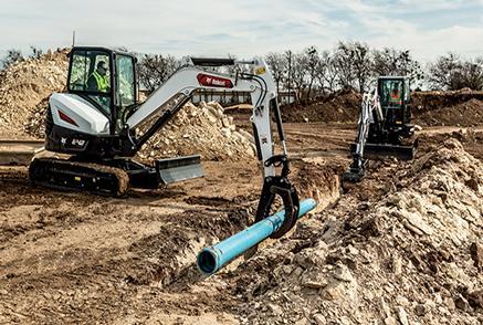 Bobcat Mini Excavators Using Excavator Attachments On Construction Jobsite