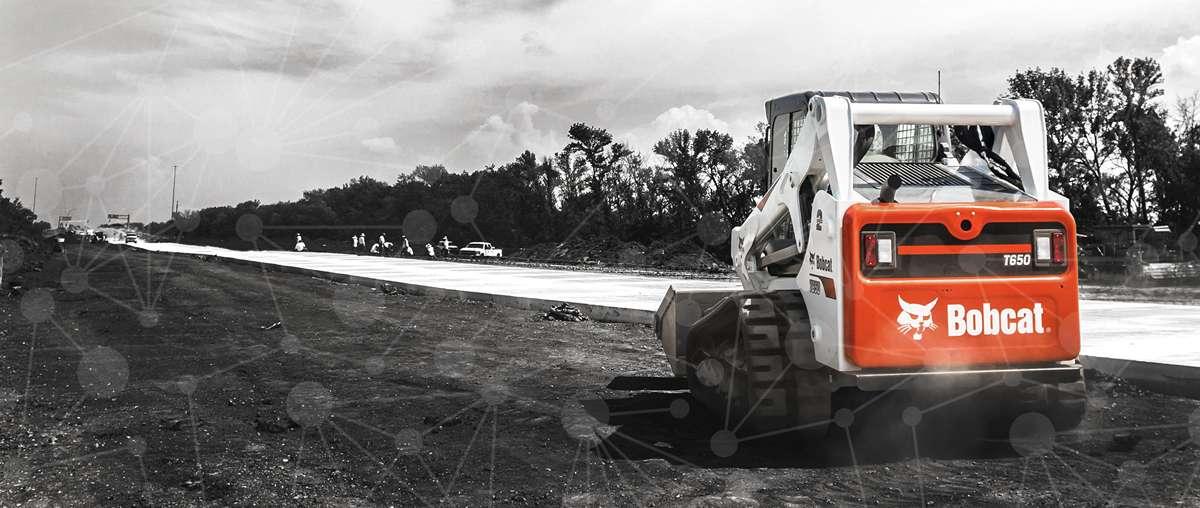 Bobcat compact track loader on a worksite.