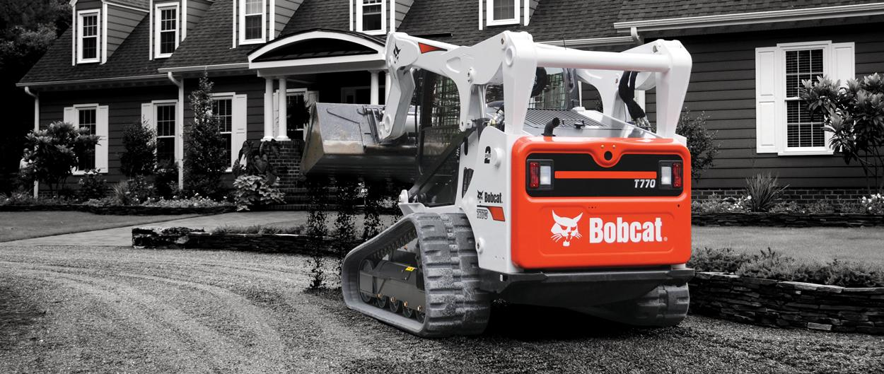 Bobcat Compact Track Loader Dumping Dirt At Landscaping Job