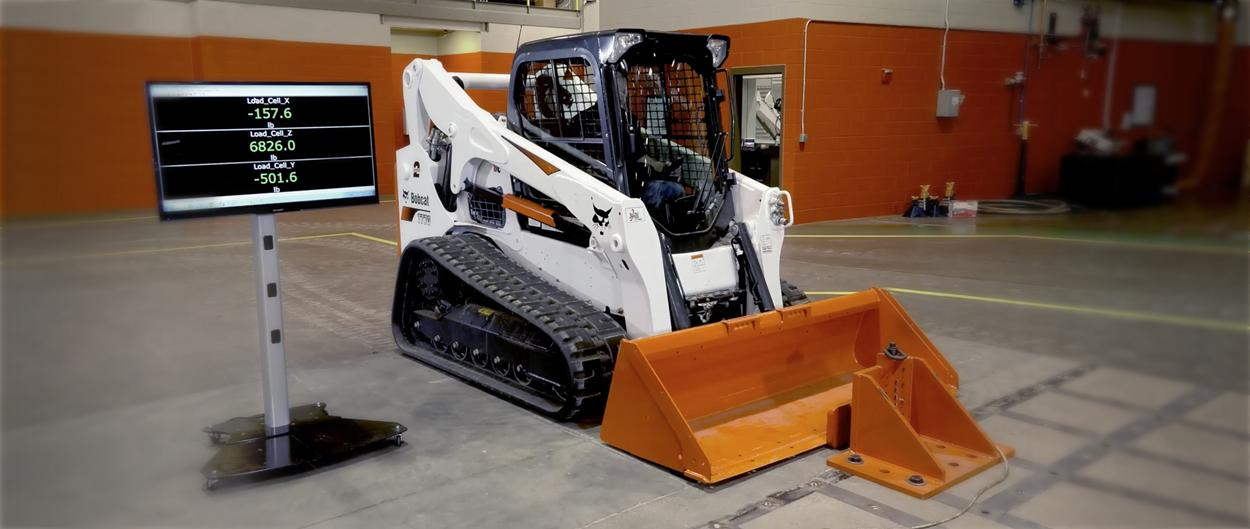 Bobcat T770 compact track loader being tested for hydraulic performance.
