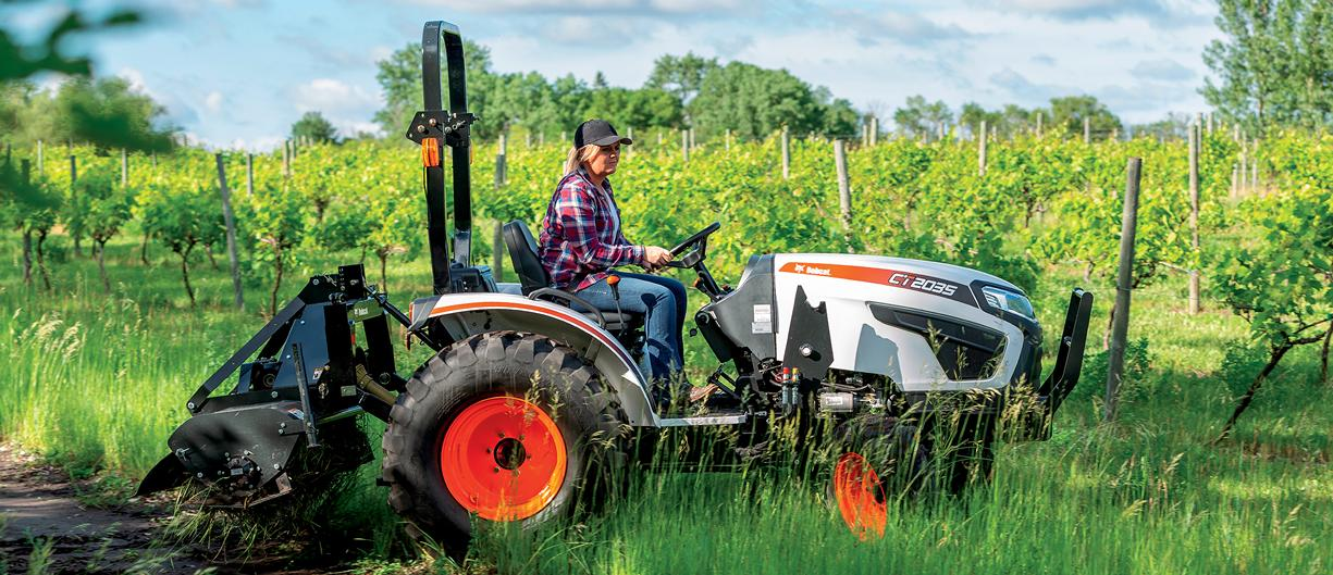 Customer uses compact tractor to till.