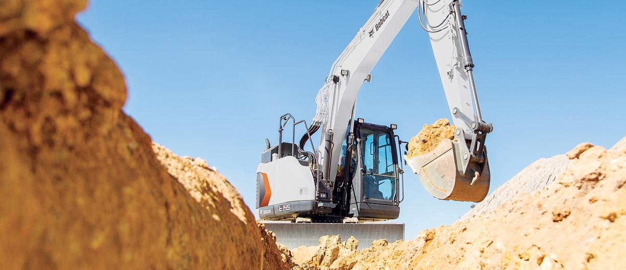 E145 compact excavator moving dirt
