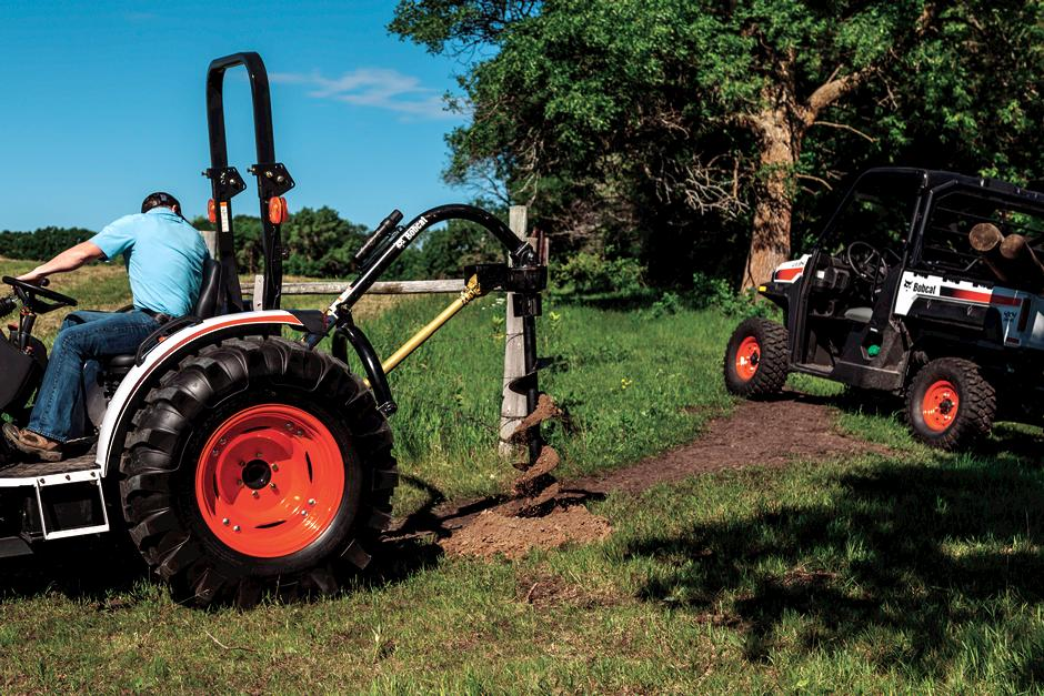 Bobcat compact tractor with auger implement.