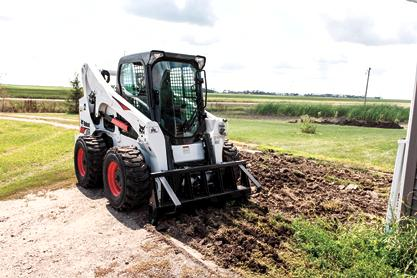 Bobcat A770 All-Wheel-Steer Loader with scarifier attachment.