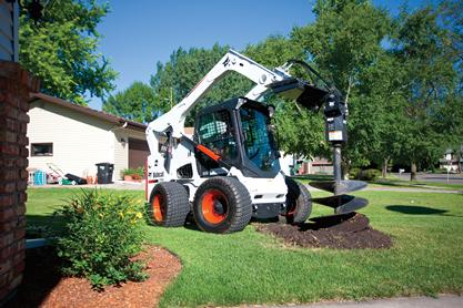 Bobcat A770 all-wheel steer loader with auger attachment.