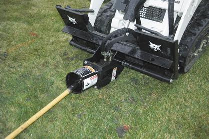 Front view of boring unit attachment on a Bobcat compact track loader.