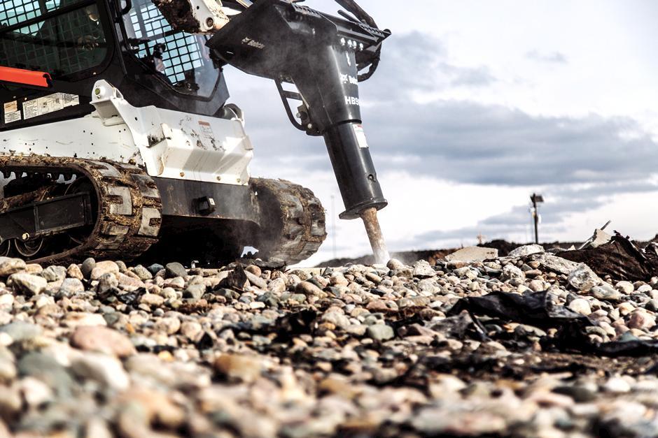 T740 Compact Track Loader Using Hydraulic Breaker Attachment To Break Through Concrete