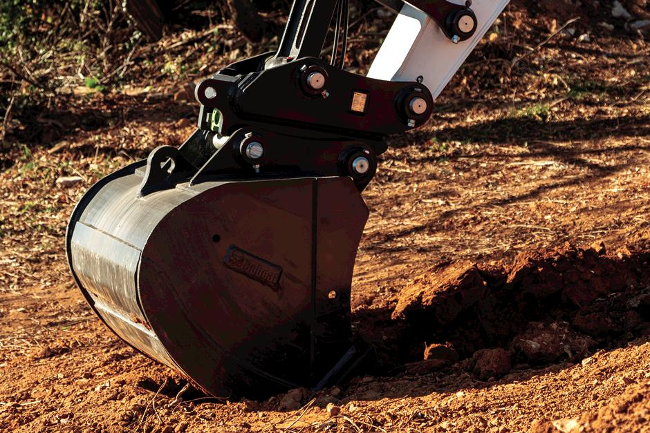 Close Up Image Of Excavator Bucket Attachment Digging Into Hard Ground