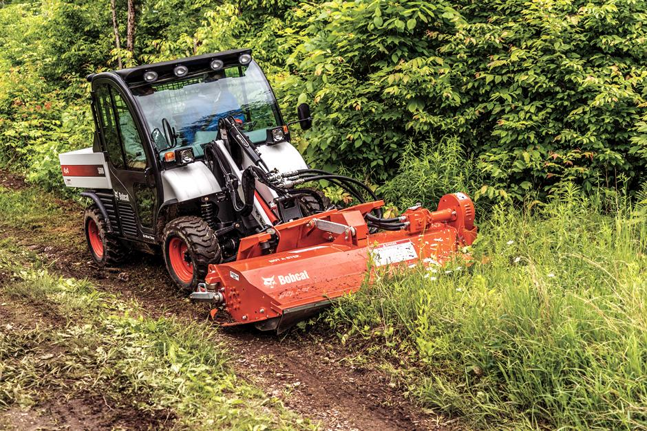 Toolcat Utility Work Machine With Flail Cutter Mowing Down Brush Along Rural Trail