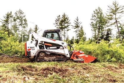 Bobcat T595 compact track loader clearing debris with flail cutter.