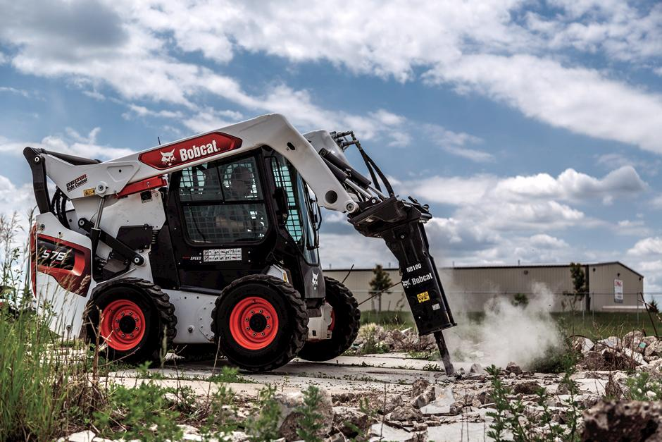 Operator Using S76 Skid-Steer Loader With Nitrogen Breaker Attachment To Break Through Concrete