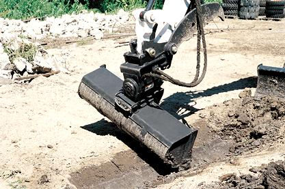 PowerTilt swing accessory on a Bobcat compact (mini) excavator.