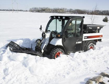 Bobcat snow V-blade attachment pushes through big snowfall with the Toolcat utility work machine.