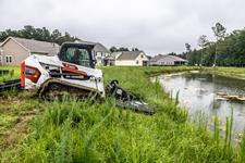 Bobcat T550 Compact Track Loader With Brushcat Attachment Mowing Ditch